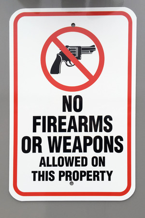 firearms: No firearms or weapons warning sign