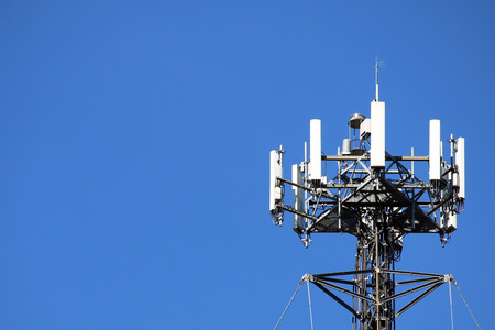 Telecommunications equipment - directional mobile phone antenna dishes. Wireless communication. 免版税图像
