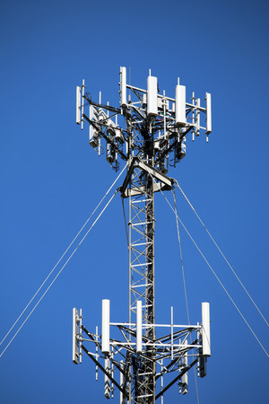 Telecommunications equipment - directional mobile phone antenna dishes. Wireless communication. Stok Fotoğraf