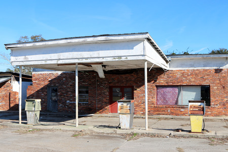 out of doors: Abandoned gas and service station.  Gas stations like this were common in most small communities decades ago, providing gas, oil and repair services for motorists.