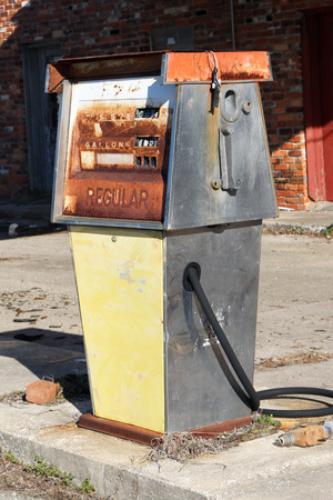abandoned gas station: Abandoned gas pump in front of a gas station