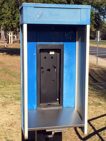 increasingly: Abandoned public telephone booth.  Pay phones are increasingly being removed due to their low usage, having been replaced by cell phones.