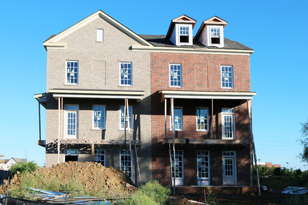 upscale: FRANKLIN, TN-SEPTEMBER, 2015:  Luxury townhomes under construction in this upscale suburb of Nashville. Editorial