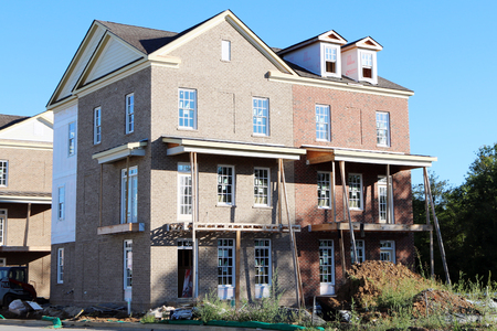 three story: FRANKLIN, TN-SEPTEMBER, 2015:  Luxury, 3 story townhomes under construction in this Nashville suburb.
