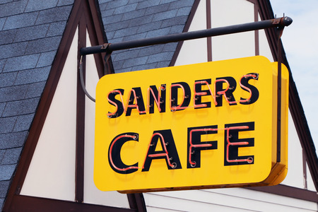 harland: CORBIN, KY-MAY, 2015:  Sign for the Sanders Cafe, the original home of Colonel Harland Sanders Kentucky Fried Chicken.  It is still an operating KFC along with a museum dedicated to all things KFC. Editorial