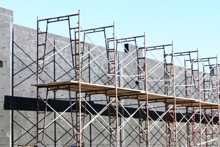 brick work: New building under construction showing the brick work and scaffolding.