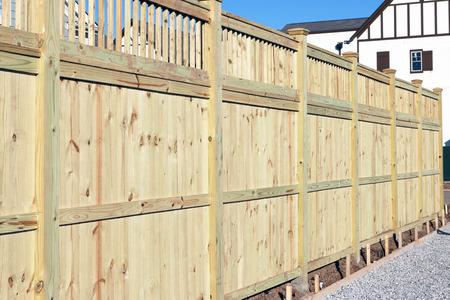 Wood fence in a housing subdivision.