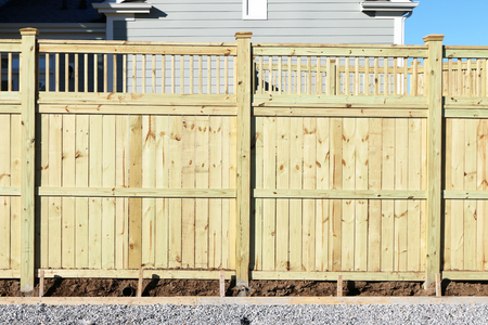 picket fence: Privacy fence in a new home development.