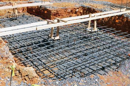cement pile: Preparing to pour a concrete foundation for home under construction. Stock Photo