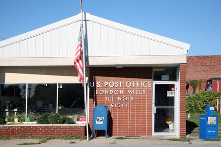 post: LONDON MILLS, IL-MAY, 2015:  Local small town post office in the midwest.  Small post offices like these are increasingly in danger of being closed due to budget constraints.