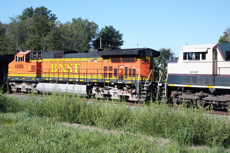hathaway: LONDON MILLS, IL-MAY, 2015:  Burlington Northern locomotive 4866 rolling through the countryside.  Burlington Northern Railroad is owned by Warren Buffets Bershire Hathaway.