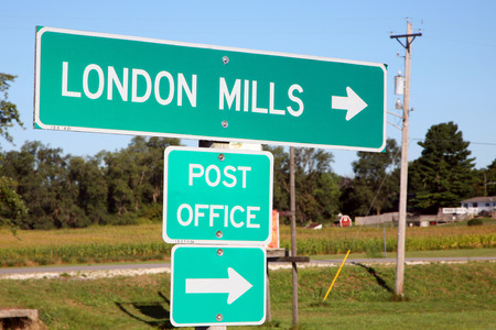 generic location: LONDON MILLS, IL-MAY, 2015:  Sign for a small midwestern farming town. Nearly unchanged in the past 100 years, London Mills is representative of many farming communities across the country.