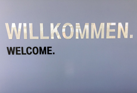 Welcom sign, written in both English and German with ample copy space for your message.