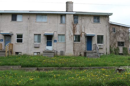 FLINT, MICHIGAN-DECEMBER 30, 2017:  Low income housing with uncut grass and weeds.  Many units are abandoned.