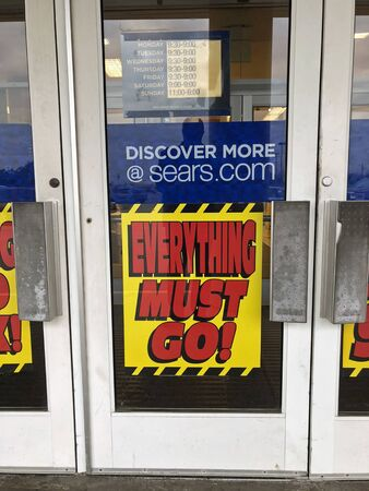 Signs on a local Sears store indicating they are going out of business. Sears was once America's largest retailer.