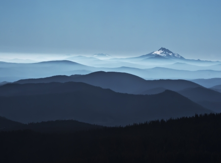 layered misty blue mountains