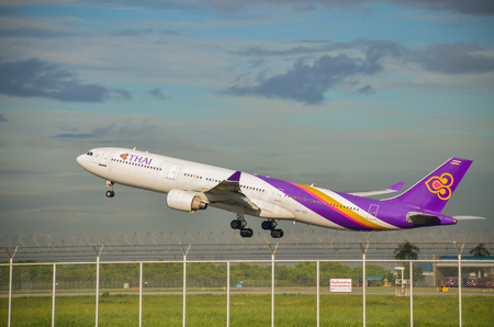 Thai airways international plane is taking of in the morning with beautiful sky : September 6, 2014 : Suvarnabhumi Airport, Thailand