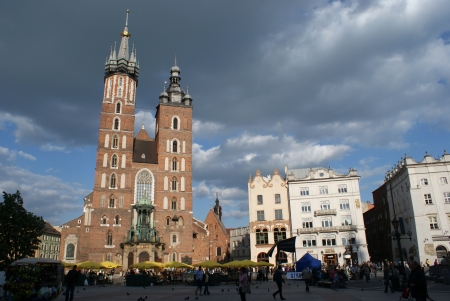 basillica: Mariacki Basillica, the most beautiful polish church and other old buildings on Main Square  Rynek Glowny  in Cracov, Poland  Editorial