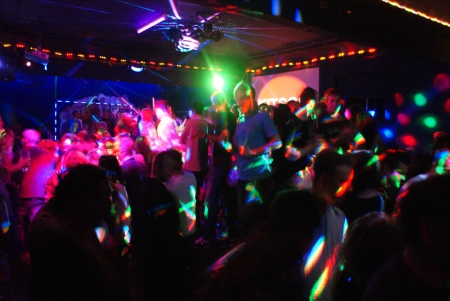 Young people dancing during party in nightclub