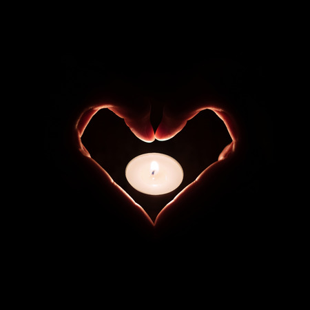 heart burn: hand and candle