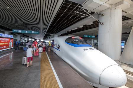 going in: Guangzhou,china - AUG,6,2016:Peoples going in the train in guangzhou south railway station.