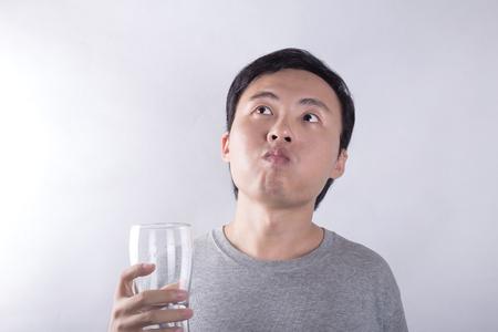 man drinking water: Asian man drinking water