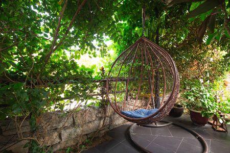 wooden chiar in the garden Standard-Bild