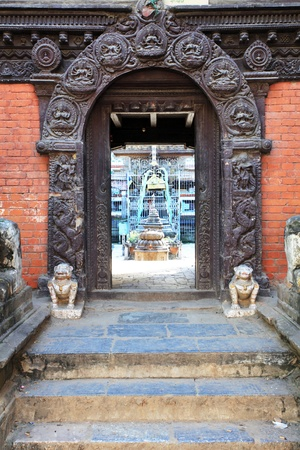 valley of the temples: hindu temple wooden carved door, bhaktapur, Nepal