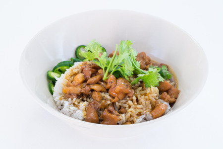 Chicken with sauce over rice photo