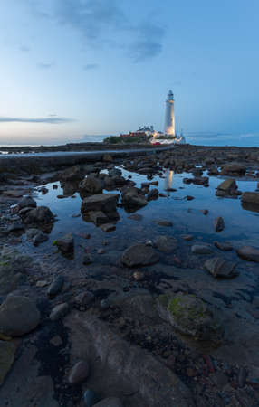 Saint Marys Lighthouse at blue hour Stock Photo