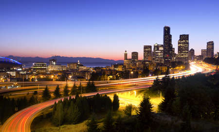 Seattle car light trails at sunset seen from a bridge Stock Photo