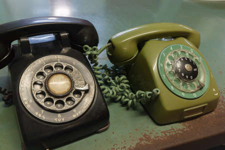 Two vintage telephones  one green, one black Stock Photo