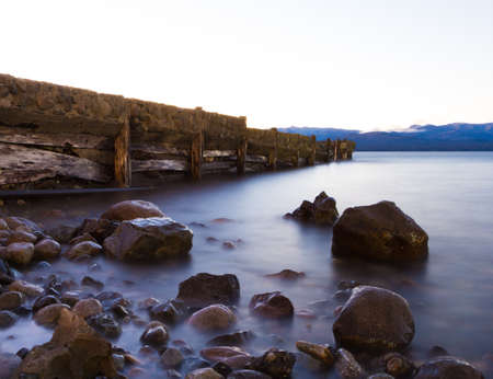 Rocks and pier in the lake in Argentina