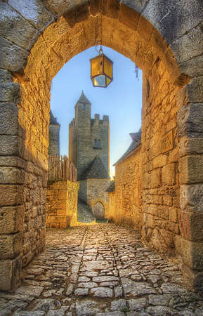 Archway with castle in the background, Beynac, France