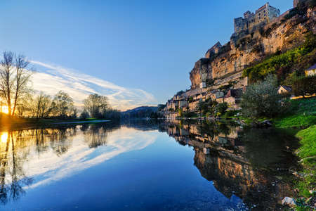 Beynac castle on a hill with the Dordogne river
