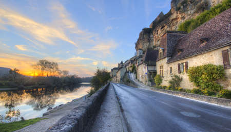 Road Through Beynac France with house, cliffs and the Dordogne river Stock Photo