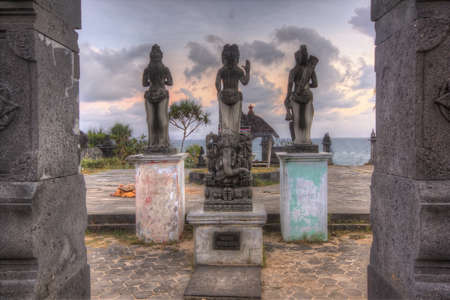 Three god statues facing the ocean at Ngobaran beach in Central Java, Indonesia Stock Photo
