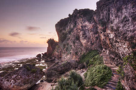 Stairs leading up the cliffs at sunset at Ngobaran beach, Indonesia