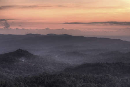 Sunset over the hills in Java, Indonesia Stock Photo