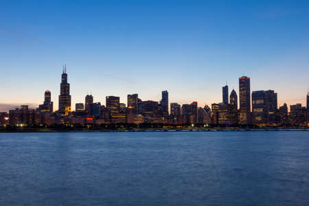 Chicago city skyline and Lake Michigan at blue hour Stock Photo