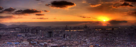 A panorama of the city of Seoul at sunset from N Seoul Tower