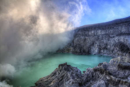 Turquoise-coloured acid crater lake in Ijen Stock Photo