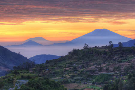 Sunset behind the mountains at Dieng Plateau