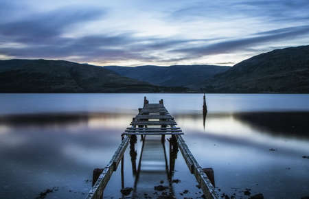 Jetty on a Lake at blue hour in Glencoe, Scotland Stock Photo