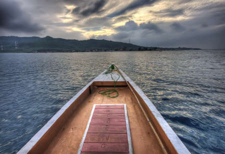 On a wooden boat crossing the ocean Stock Photo