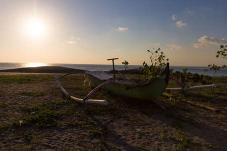 Abandoned catamaran washed up on the beach in Bali