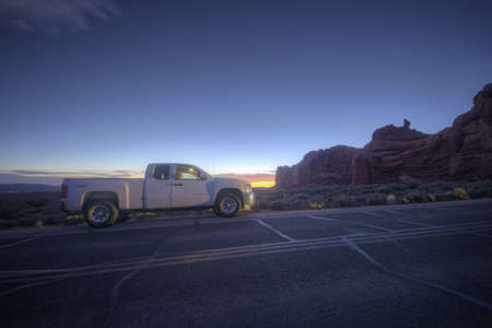 Pick-up truck on the road in Arches National Park Stock Photo