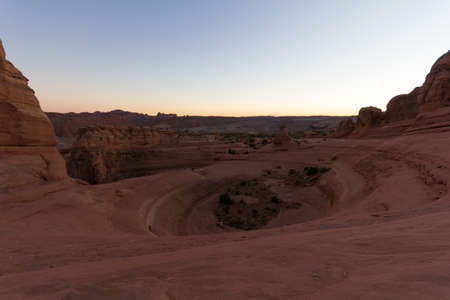 Arches National Park in the desert at sunset