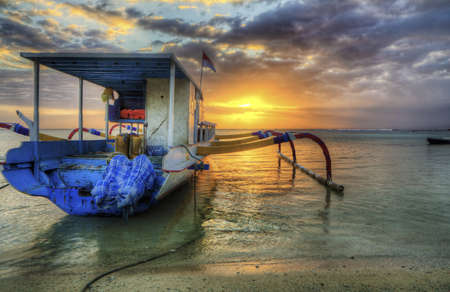 Boat on the beach at sunset in Nusa Lembongan