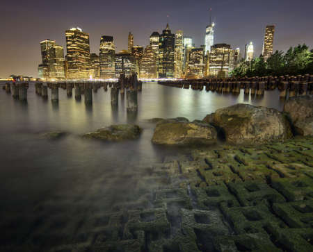 New York City skyline at night seen from Brooklyn Stock Photo